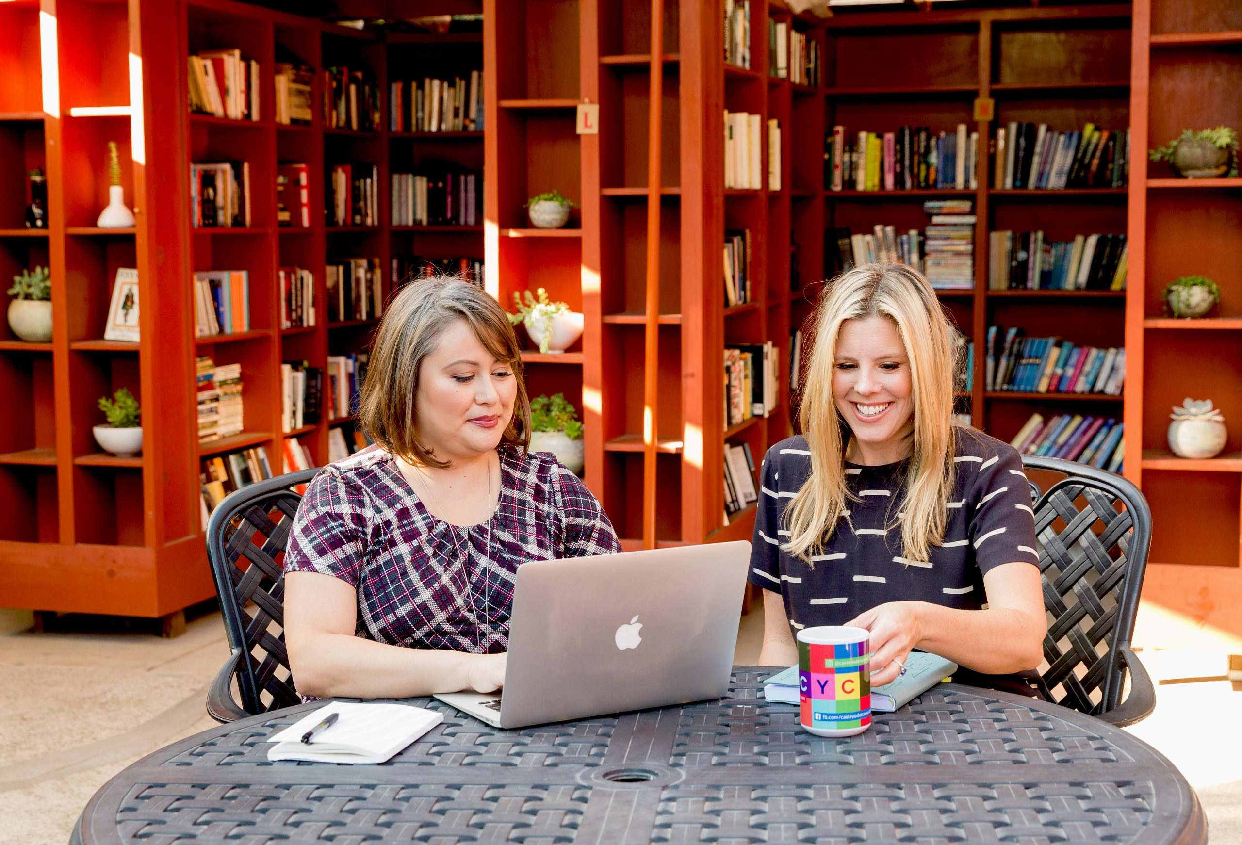 Casie Yoder Consulting Header Image with Casie Yoder and Liz Ireland sitting at a table